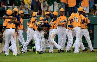 Members of Chicago's Jackie Robinson West Little League team celebrate Saturday, August 23, 2014 after a 7-5 win over Las Vegas during the U.S. Championship game of the Little League World Series at Lamade Stadium in South Williamsport, Pa.Rob Carr/Getty Images