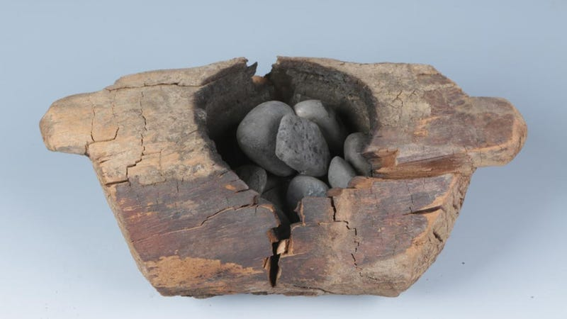 One of the wooden braziers dug up from the burial site in Central Asia.