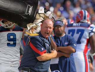 Illustration for article titled Bills Celebrate 8th Straight Loss By Dumping Contents Of Garbage Can On Coach