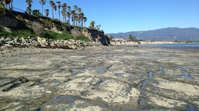 Exposed bedrock on the beach near the University of California, Santa Barbara, in February 2017. (Image: Daniel Hoover, USGS)