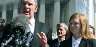 Plaintiff Abigail Fisher with attorney after Supreme Court heard arguments. (Mark Wilson/Getty Images News)