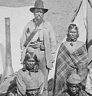 Winema (Tobey) Riddle, a Modoc, and husband Frank (left), 1873 (National Archives 165-MM-1624)