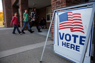Voters turn out to cast their ballots at a polling station Nov. 4, 2014, in Westport, Conn. Spencer Platt/Getty Images