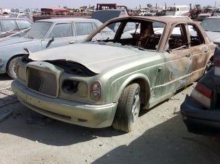 Illustration for article titled Qatar Junkyard A Treasure Trove Of Automotive Oddities