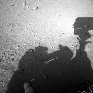 Illustration for article titled A New NASA Conspiracy: Does This Photo Show a Man Fixing the Mars Rover?