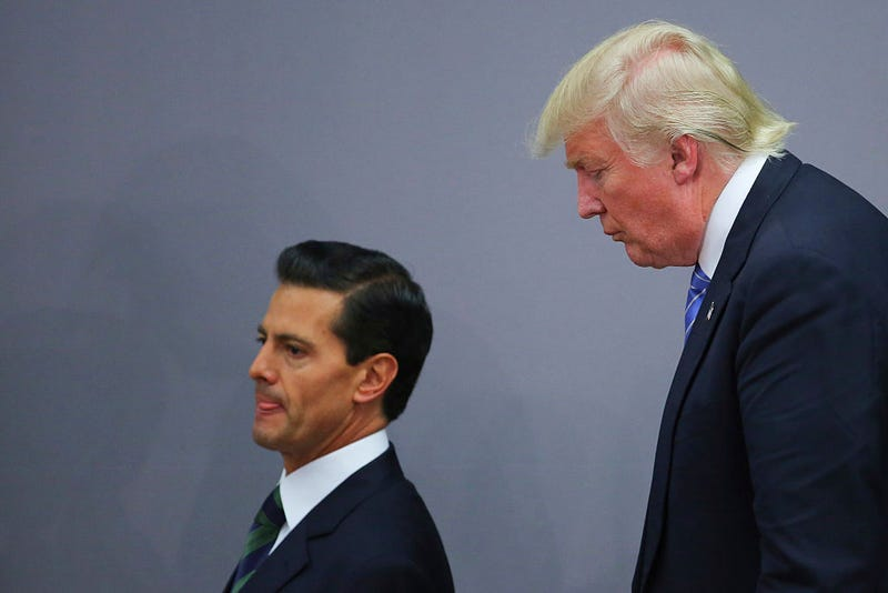 President of Mexico Enrique Peña Nieto walks with then-Republican presidential candidate Donald Trump after a meeting Aug. 31, 2016, in Mexico City. (Hector Vivas/LatinContent/Getty Images)