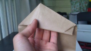 Illustration for article titled Give Any Paper Bag a Handle With Simple Origami