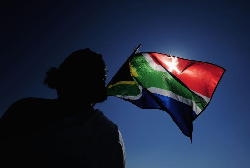 A South African flag is waved ahead of the 2010 FIFA World Cup.