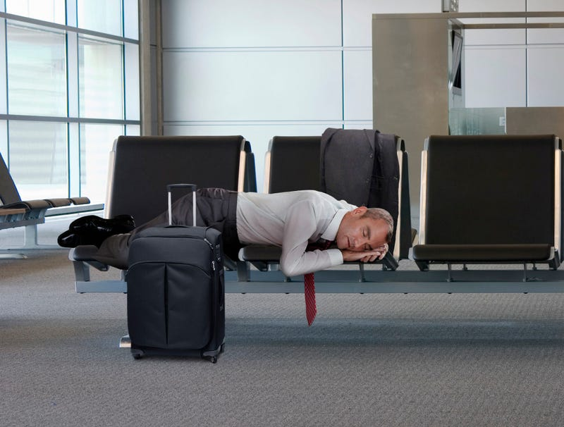 Illustration for article titled Sleeping Middle-Aged Businessman In Airport Suddenly So Childlike, So Vulnerable