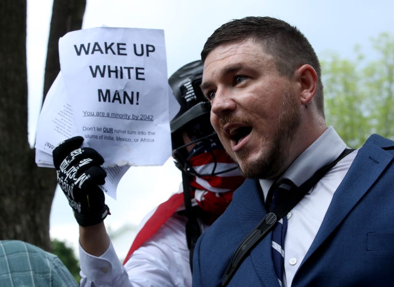 Jason Kessler, who organized the rally, speaks as white supremacists, neo-Nazis, members of the Ku Klux Klan and other hate groups gather for the Unite the Right rally in Lafayette Park across from the White House August 12, 2018, in Washington, D.C.