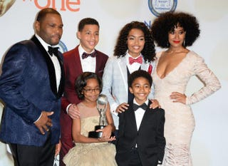 Clockwise from top left: Anthony Anderson, Marcus Scribner, Yara Shahidi, Tracee Ellis Ross, Miles Brown and Marsai Martin pose with the award for Outstanding Television Comedy Series for Black-ish in the press room at the 46th NAACP Image Awards at the Pasadena Civic Auditorium in California Feb. 6, 2015.  ROBYN BECK/AFP/Getty Images