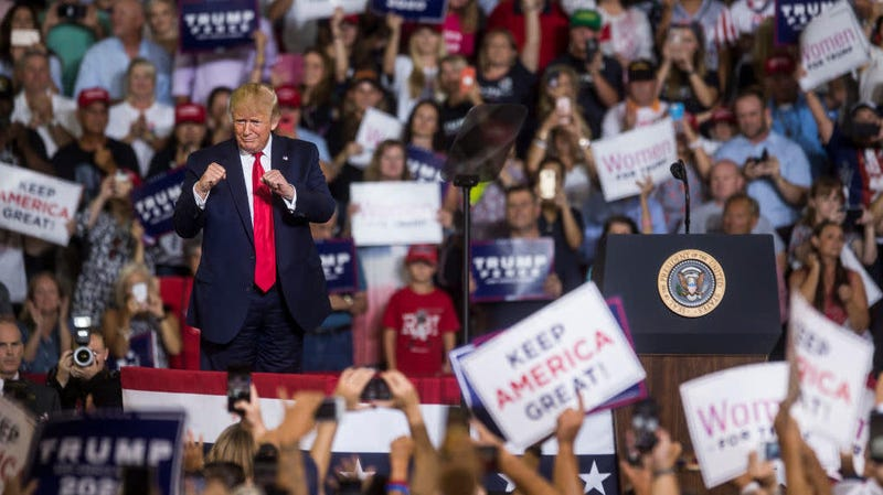 """Donald Trump takes the podium before speaking during a political rally on July 17, 2019, in Greenville, N.C., where supporters chanted """"Send her back"""" in reference to frequent Trump critic Rep. Ilhan Omar."""