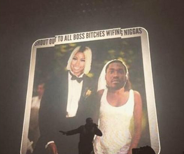 Drake performs at the 2015 OVO Fest in front of a jumbo screen with an altered photo featuring the faces of Nicki Minaj and Meek Mill. Screenshot