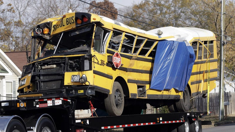 The bus being taken from the scene of the accident. Photo via AP