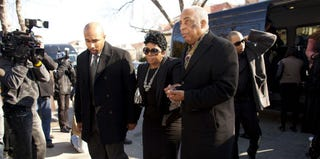 Carol Gray (C), mother of Kimani Gray, is escorted into her son's funeral. (Ramin Talaie/Getty Images)