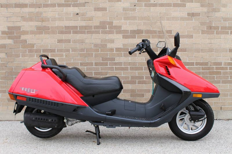 Illustration for article titled At $2,499, Could This Incredibly Low Mileage 1999 Honda CN250 Helix Get You To Scoot?