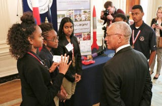 Charles Bolden, administrator of NASA, listens to Shimeeka Stanley, 15, of the U.S. Virgin Islands explain the group's science presentation during the White House Science Fair at the White House Monday, March 23, 2015, in Washington, D.C.Nicole L. Cvetnic/The Root