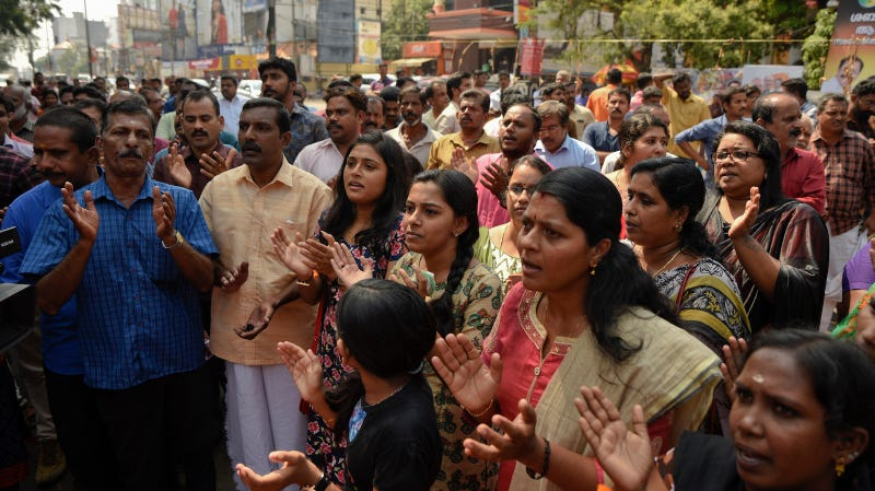 Hindus chant devotional songs during a protest against reports of two women of menstruating age entering the Sabarimala temple, one of the world's largest Hindu pilgrimage sites, in Thiruvananthapuram, Kerala, India, Wednesday, Jan. 2, 2019.