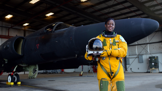 """Lt. Col. Merryl Tengesdal, 9th Reconnaissance Wing inspector general and U-2 """"Dragon Lady"""" pilot, in front of a U-2 plane Feb. 9, 2015, at Beale Air Force Base, Calif.Beale Air Force Base"""