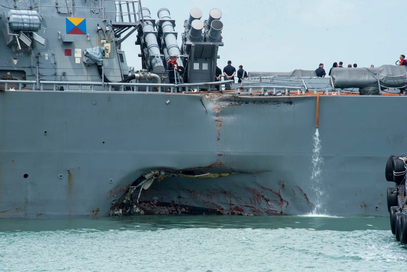 Damage to the USS John S. McCain is visible as it steers towards Changi Naval Base in Singapore following a collision (U.S. Navy photo by Mass Communication Specialist 2nd Class Joshua Fulton/Released)