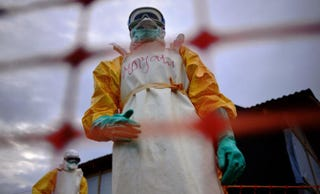 Medecins Sans Frontieres medical staff wearing protective clothing treat the body of an Ebola victim at their facility in Sierra Leone's Kailahun district on Aug. 14, 2014.CARL DE SOUZA/AFP/Getty Images