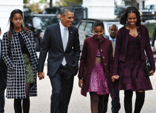 President Barack Obama and first lady Michelle Obama walk with daughters Malia and Sasha across Lafayette Park to St. John's Episcopal Chuch on Oct. 27, 2013, in Washington, D.C.MANDEL NGAN/AFP/Getty Images