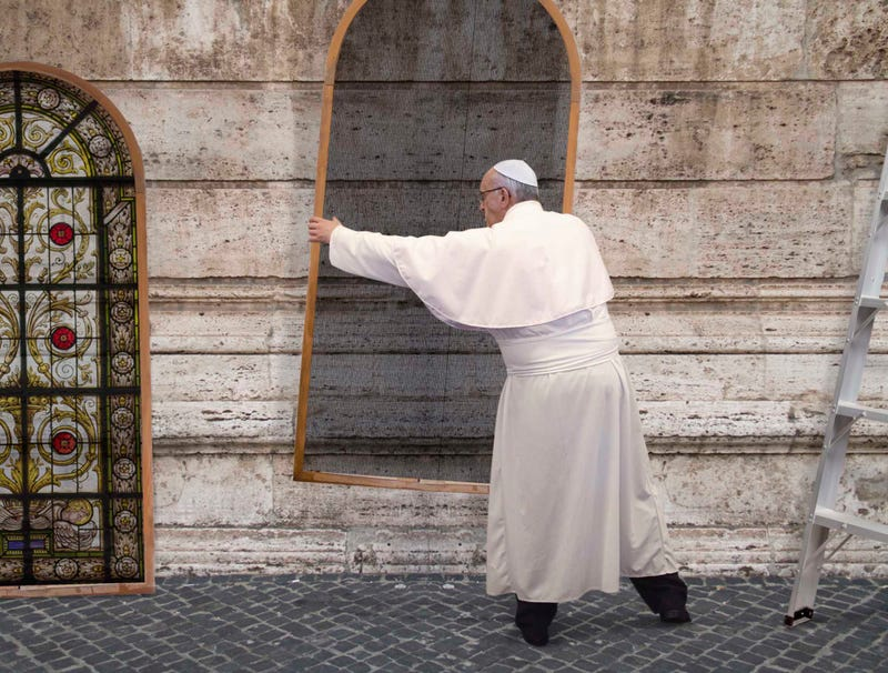 Illustration for article titled Pope Francis Spends Weekend Installing Stained Glass Storm Windows In St. Peter's Basilica