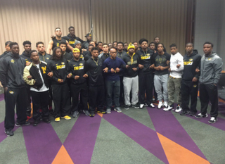 University of Missouri, Columbia's football players and staff link arms to protest racist conditions on campus.Twitter
