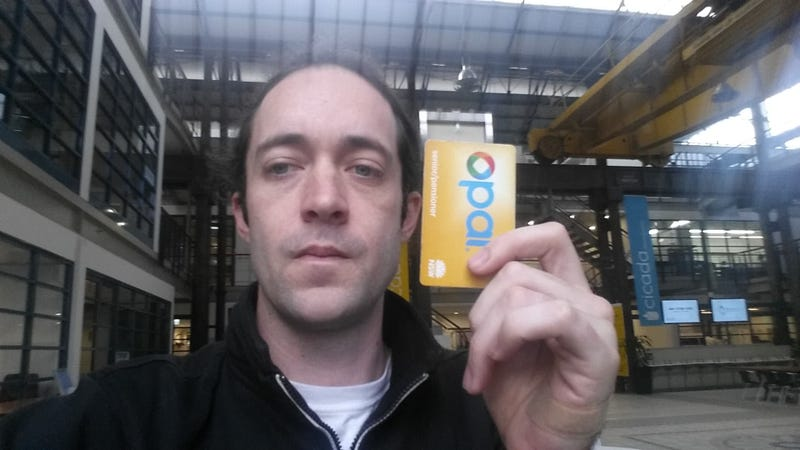 Meow-Ludo Disco Gamma Meow-Meow with an Opal transit pass. He has a version of the pass implanted in his hand.