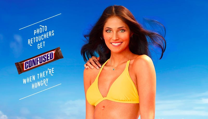 Illustration for article titled Snickers Places an Ad Making Fun of Overzealous Retouching on the Back of SI's Swimsuit Issue