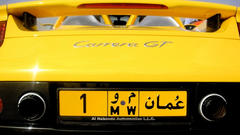 Illustration for article titled With A Vanity Plate Like This, You Get The Porsche Carrera GT Thrown In For Free