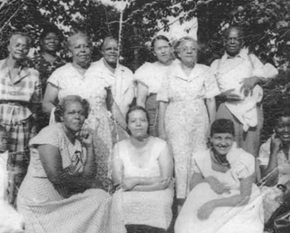 Helen Davis (center, front row) and Jennie Marshall Davis (hand on Davis' shoulder) at a Marshal family reunion, date unknownAnn Brown