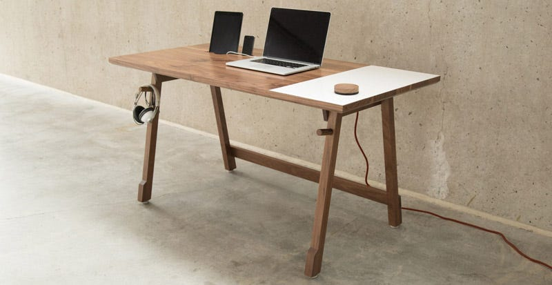 Illustration for article titled This Desk Keeps Your Cords In Order and Has a Built-In Whiteboard