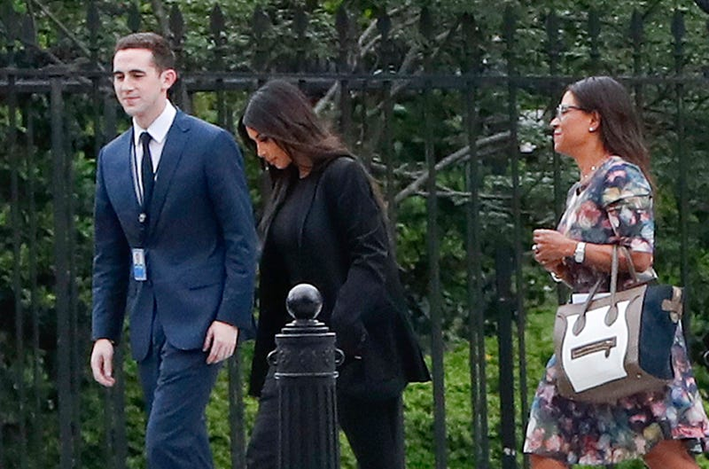 Kim Kardashian West (center) arrives at the security entrance of the White House in Washington, D.C., on May 30, 2018.