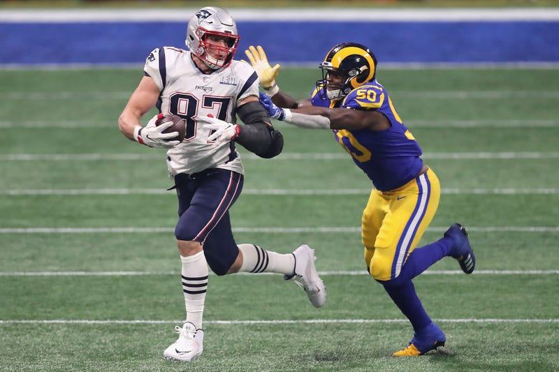 Rob Gronkowski #87 of the New England Patriots runs the ball against Samson Ebukam #50 of the Los Angeles Rams in the second half during Super Bowl LIII at Mercedes-Benz Stadium on February 3, 2019 in Atlanta, Georgia.