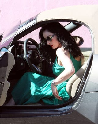Illustration for article titled Dita Von Teese: Old School Glamour In A New School Car