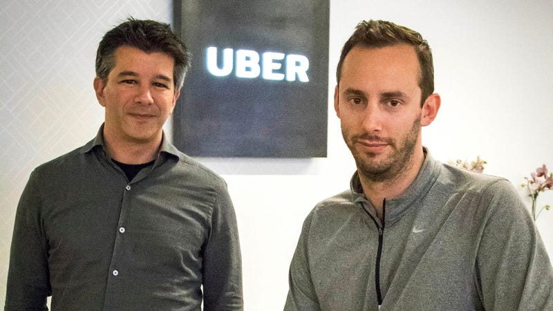 Then-Uber CEO Travis Kalanick, left, and Anthony Levandowski, co-founder of Otto, pose for a photo in the lobby of Uber headquarters, in San Francisco. Photo: AP