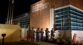 National Guard troops stand outside the police department in Ferguson, Mo., after violent protests engulfed the area Nov. 25, 2014, when a grand jury decided not to indict Officer Darren Wilson in the killing of teenager Michael Brown.  Aaron P. Bernstein/Getty Images