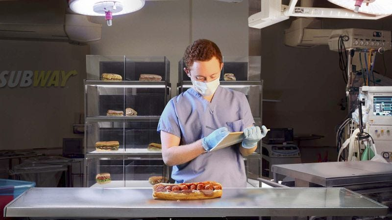 A technician examines the hybrid specimen inside Subway's sandwich breeding facility, where the first miniature 6-inch breeds of subs were originally developed in the late 1960s.