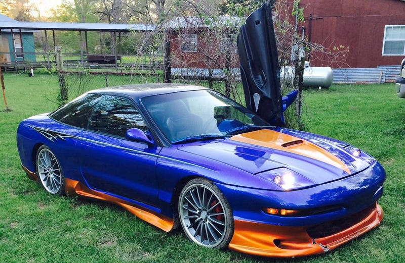 Illustration for article titled For $4,000, This Custom 1997 Ford Probe Could Let You Reach Your Inner 'Vette Lover