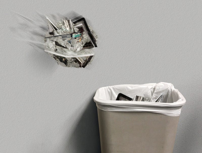 Illustration for article titled Frustrated Writer Tosses Another Crumpled-Up Laptop In Trash Can