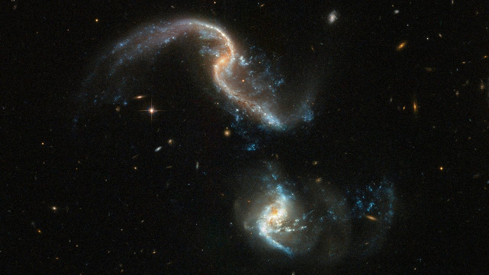 The Hubble Space Telescope Captured This Beautiful Image of Two Galaxies Merging