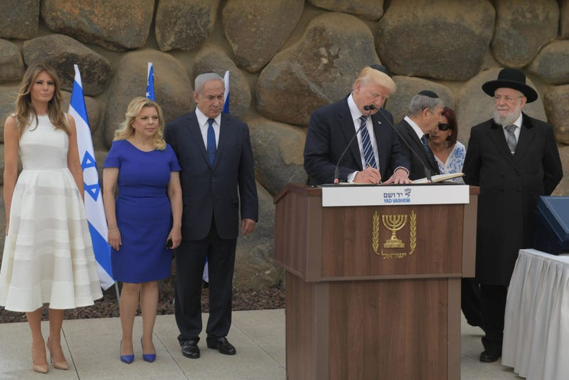 President Donald Trump, at podium, visiting the Yad Vashem World Holocaust Remembrance Center, accompanied by Israeli Prime Minister Benjamin Netanyahu (third from left), on May 23, 2017, in Jerusalem (Amos Ben Gershom/GPO via Getty Images)