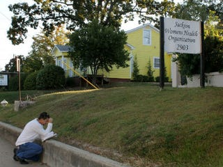 Man prays outside Mississippi's sole abortion clinic (Bloomberg/Getty Images)