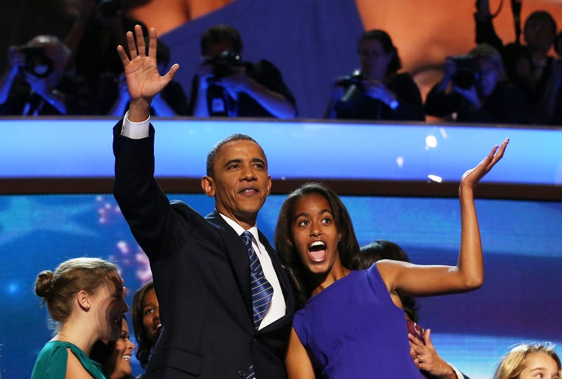 President Barack Obama waves onstage with Malia Obama during the final day of the Democratic National Convention at Time Warner Cable Arena in Charlotte, N.C., on Sept. 6, 2012.Chip Somodevilla/Getty Images