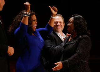 OWN's Oprah Winfrey reacts as television producer and writer Shonda Rhimes gets up to receive her W.E.B. Du Bois Medal as Weinstein Co. Co-Chairman Harvey Weinstein looks on during the Hutchins Center Honors W.E.B. Du Bois Medal Ceremony in Cambridge, Mass., on Sept. 30, 2014.Jessica Rinaldi/The Boston Globe via Getty images