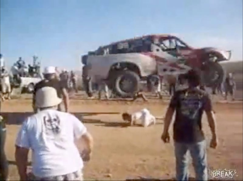 Illustration for article titled VIDEO: Insane Baja Fan Ducks Under Jumping Truck