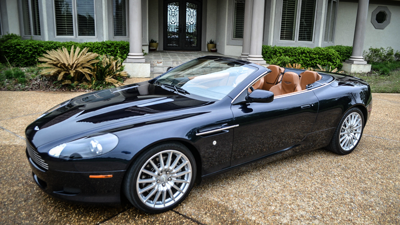 Illustration for article titled Why Buy A Used M3 When You Can Get A Sexy V12 Aston Martin Convertible?