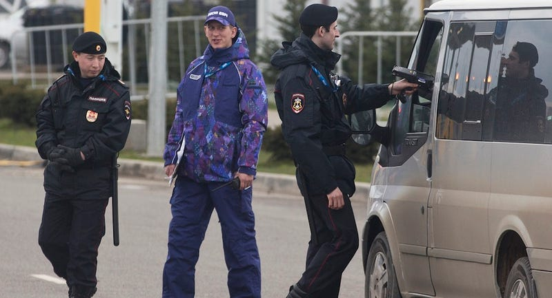 Illustration for article titled Sochi Makes Terrifying Police Less Scary With Fab Purple Uniforms