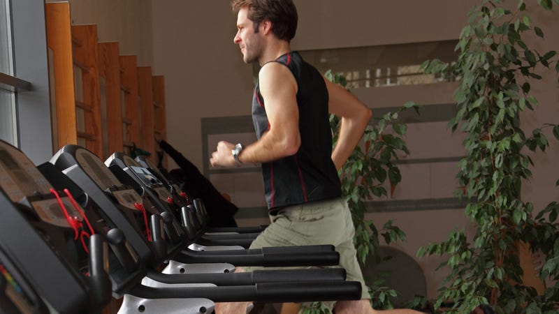 Illustration for article titled A Titan Of Sport: This Man At The Gym Is All-Out Sprinting On The Treadmill In Cargo Shorts While Watching Old Episodes Of 'River Monsters' On A Microsoft Surface Tablet